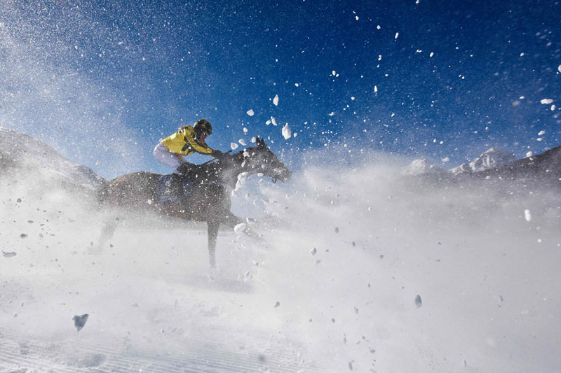 Horses race on a frozen lake at Swiss resort's White Turf event