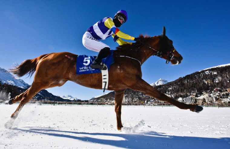 Fabris Jindrich with his horse Hello Goodby competes during the flat race of the White Turf horse racing event in St. Moritz on February 19, 2017. The races are held on the frozen lake of the Swiss mountain resort. (MICHAEL BUHOLZER/AFP/Getty Images)