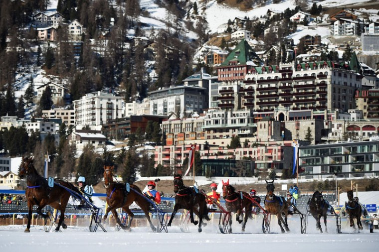 Competitors take part in the trotting race at the White Turf horse racing event in St Moritz on February 19, 2017. (MICHAEL BUHOLZER/AFP/Getty Images)
