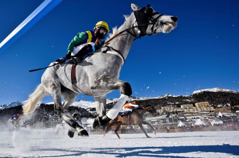 Raphael Lingg with horse Sleeping Giant takes part in the 1800 meters flat race at the White Turf horse racing event in St Moritz on February 19, 2017. (MICHAEL BUHOLZER/AFP/Getty Images)