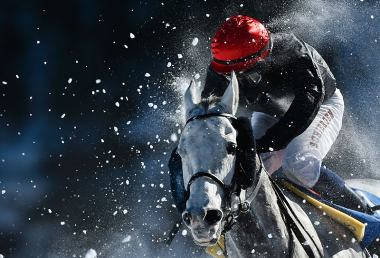 Dennis Schergen on his horse Eyecatsher competes in the 1600 meters at the White Turf horse racing event in St Moritz on February 19, 2017. (MICHAEL BUHOLZER/AFP/Getty Images)