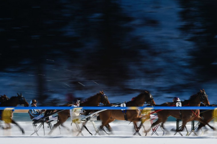 Competitors take part in the 1700 meters trotting race at the White Turf horse racing event in St Moritz on February 19, 2017. (MICHAEL BUHOLZER/AFP/Getty Images)
