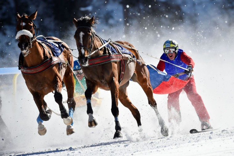Adrian Von Guten with his horse Mombasa competes in the Skikjoering race at the White Turf horse racing event in St Moritz on February 19, 2017. (MICHAEL BUHOLZER/AFP/Getty Images)