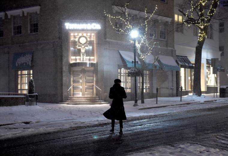 A woman crosses Greenwich Avenue in the snow in downtown Greenwich, Connecticut as a Winter storm hits the northeast United States, January 7, 2017, causing blizzard like conditions. (Timothy A. Clary/AFP/Getty Images)
