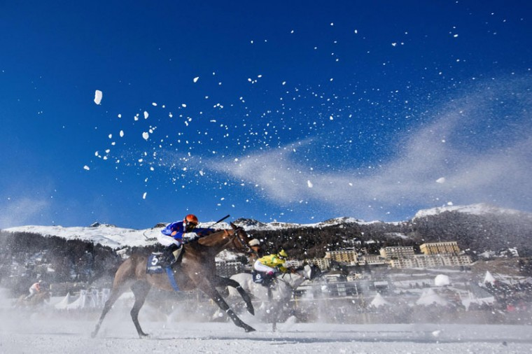 Clement Lheureux on his horse Cominols and Milan Zatloukal on his horse Arche Pink take part in the 1800 meters flat race at the White Turf horse racing event in St Moritz on February 19, 2017. (MICHAEL BUHOLZER/AFP/Getty Images)