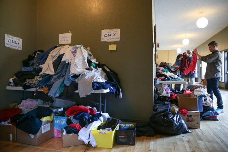 Volunteers fold clothes at an emergency shelter on February 14, 2017 in Chico, California. More than 188,000 people were ordered to evacuate after a hole in the emergency spillway in the Oroville Dam threatened to flood the surrounding area.  (Elijah Nouvelage/Getty Images)