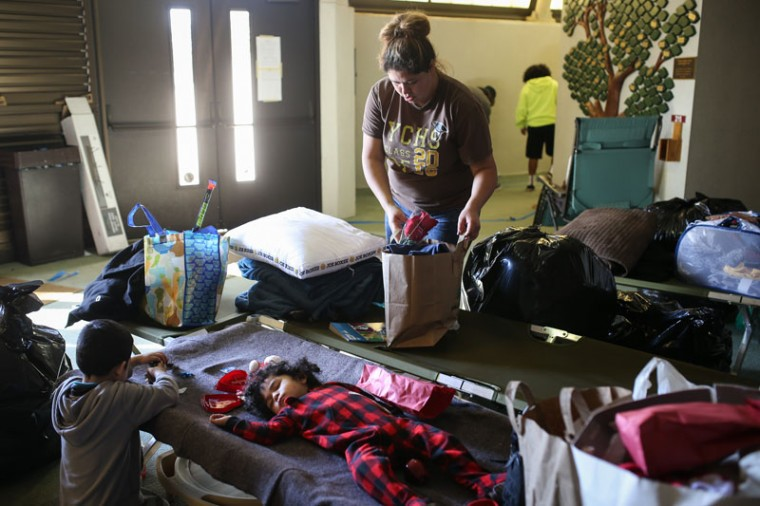 Tanisha Mosqueda packs her belongings in an emergency shelter after a mandatory evacuation order in place since Sunday was downgraded to an advisory on Feb. 14, 2017 in Chico, California. More than 188,000 people were ordered to evacuate after a hole in the emergency spillway in the Oroville Dam threatened to flood the surrounding area. (Elijah Nouvelage/Getty Images)