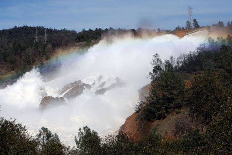 The Oroville Dam spillway overflows with runoff in Oroville, California on Feb. 14, 2017. A sheriff  lifted a mandatory evacuation order in northern California, which had impacted nearly 200,000 people in an area under threat of catastrophic failure at the tallest dam in the United States. (MONICA DAVEY/AFP/Getty Images)
