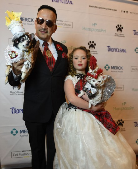 Anthony Rubio and Bridilla from England and contestants in the World Fashion Presents segment pose during the 14th Annual New York Pet Fashion Show presented by TropiClean at the Hotel Pennsylvania February 9, 2017. (TIMOTHY A. CLARY/AFP/Getty Images)