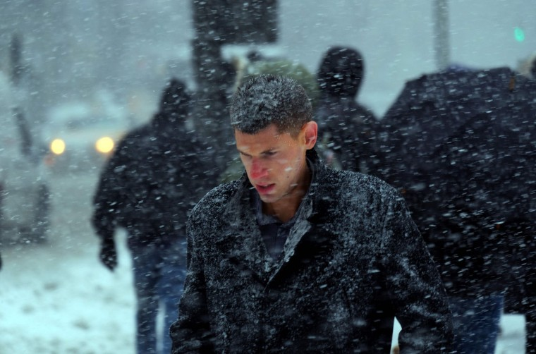 A man crosses a street during a winter storm in New York on February 9, 2017. A heavy winter snow storm lashed the northeastern United States Thursday, subjecting New York to near blizzard-like conditions and forcing flight cancellations as schools and the United Nations closed. (Jewel Samad/AFP/Getty Images)
