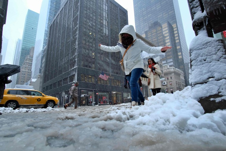 A woman crosses a street during a winter storm in New York on February 9, 2017. A heavy winter snow storm lashed the northeastern United States Thursday, subjecting New York to near blizzard-like conditions and forcing flight cancellations as schools and the United Nations closed. (Jewel Samad/AFP/Getty Images)