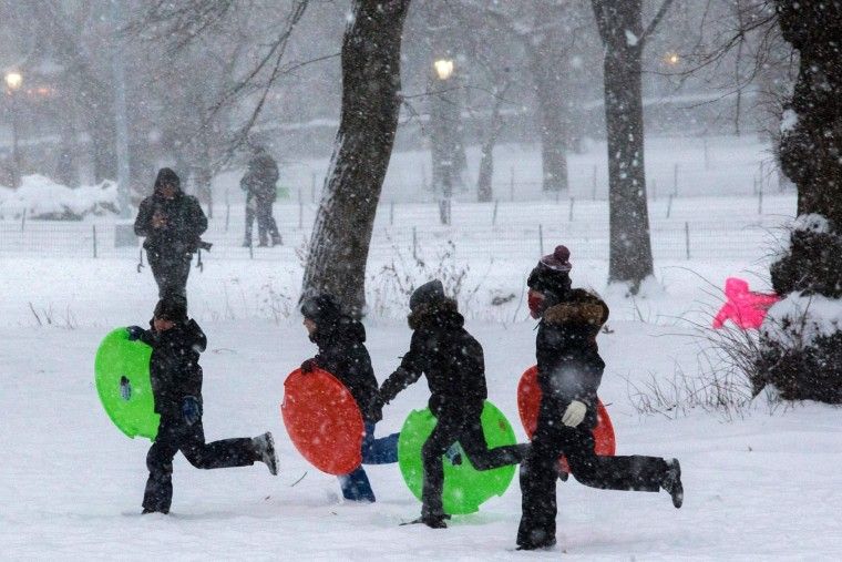 Children play under a snowfall in Central Park during a winter storm on January 7, 2017 in New York. (Eduardo Munoz Alvarez/Getty Images)