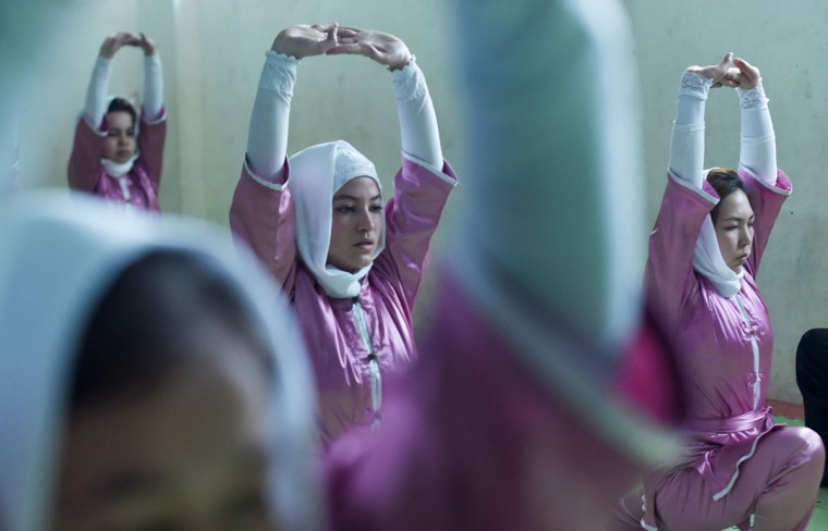In this photograph taken on January 21, 2017, Afghan members of a wushu martial arts group take part in a traning session in Kabul. Afghanistan's first female wushu trainer, Sima Azimi, 20, is training 20 Afghan girls aged between 14 - 20 at a wushu club in Kabul, after learning the sport while living as a refugee in Iran.
