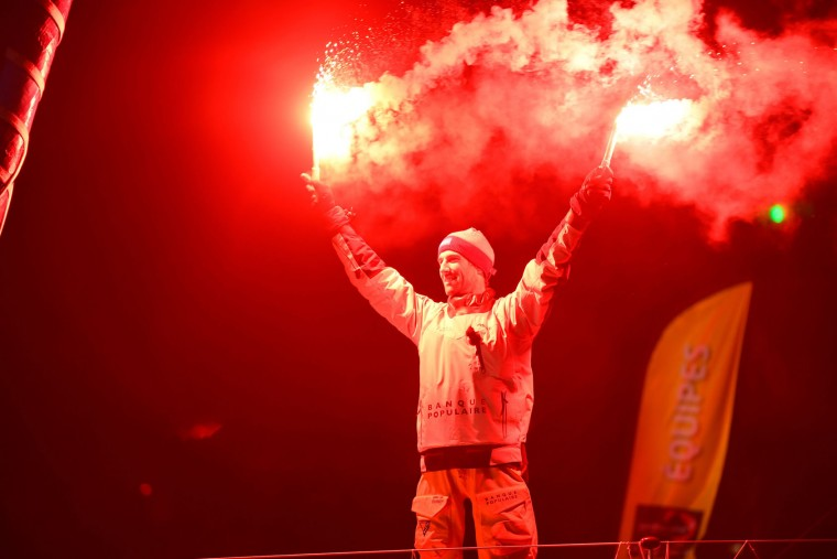 French skipper Armel Le Cleac'h celebrates aboard his Imoca monohull after crossing the finish line of the Vendee Globe solo around the world sailing race, on January 19, 2017 off Les Sables d'Olonne, western France. French skipper Armel Le Cleac'h won the Vendee Globe solo round the world yacht race on January 19, 2017 in a record time. (Damien Meyer/AFP/Getty Images)