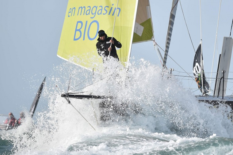 """French skipper Romain Attanasio, celebrates and smiles aboard of his Imoca 60 monohull """"Famille Mary-Etamine du Lys"""" as he arrives 15th in les Sables-d'Olonne at the end of his Vendee Globe around-the-world solo sailing race on February 24, 2017 in Les Sables-d'Olonne, western France. (Jean-Sebastien Evrard/AFP/Getty Images)"""