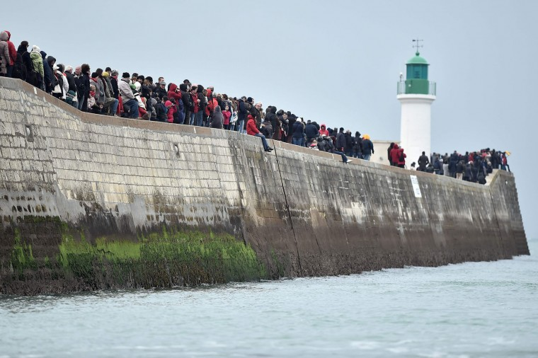 People wait for the arrival of Spanish skipper Didac Costa at the end of the Vendee Globe around-the-world solo sailing race on February 23, 2017 in Les Sables-d'Olonne, western France. Costa, who was taking part in the race for the first time, finished 14th. (Jean-Sebastien Evrard/AFP/Getty Images)