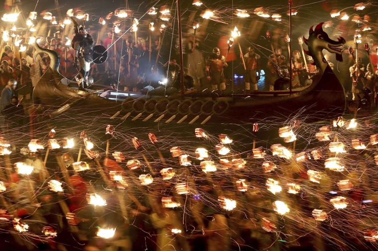 Members of the Jarl Squad dressed in Viking costumes carry flaming torches during the Up Helly Aa Viking festival in Lerwick on the Shetland Isles, Scotland, Tuesday Jan. 31, 2017. (Jane Barlow/PA via AP)