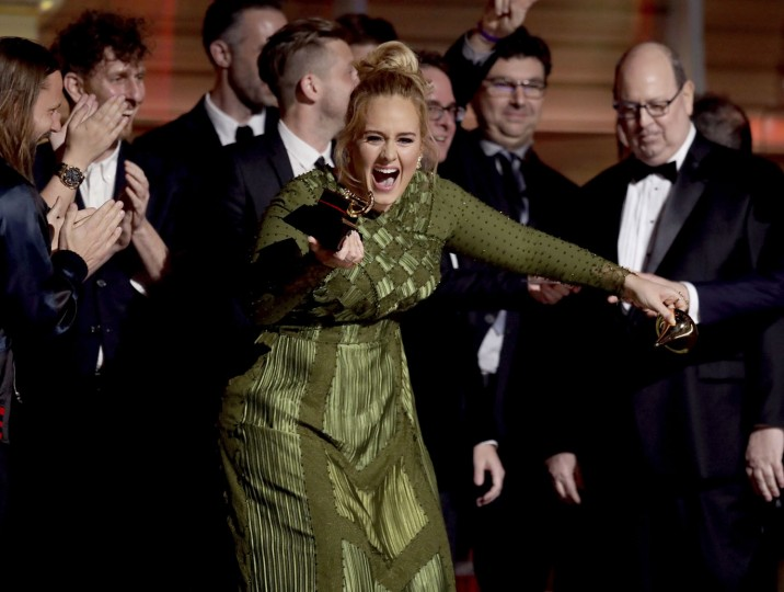 "Adele accepts the award for album of the year for ""25"" at the 59th annual Grammy Awards on Sunday, Feb. 12, 2017, in Los Angeles. (Photo by Matt Sayles/Invision/AP)"