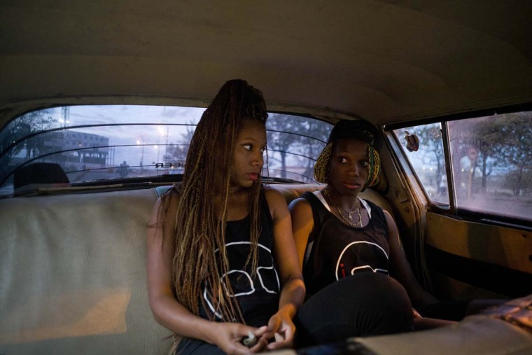 In this Jan. 30, 2017 photo, boxers Idamerys Moreno, left, and Legnis Cala, ride home in a taxi after training, in Havana, Cuba. Female athletes in Cuba have made strides in many other sports, including wrestling, judo and most recently, weightlifting, but not in boxing. (AP Photo/Ramon Espinosa)