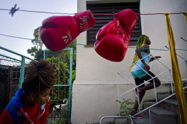 "In this Jan. 19, 2017 photo, boxer Legnis Cala runs up a flight of stairs in the backyard of her house, in Havana, Cuba. ""I see myself at the Olympics in Japan 2020,"" Moreno said. ""That's my dream."" Pictured at bottom left is boxer Idamerys Moreno. (AP Photo/Ramon Espinosa)"