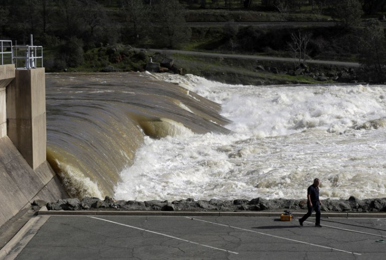 The Feather River flows with force through Oroville, Calif., downstream from a damaged dam Tuesday, Feb. 14, 2017. (Marcio Jose Sanchez/AP)