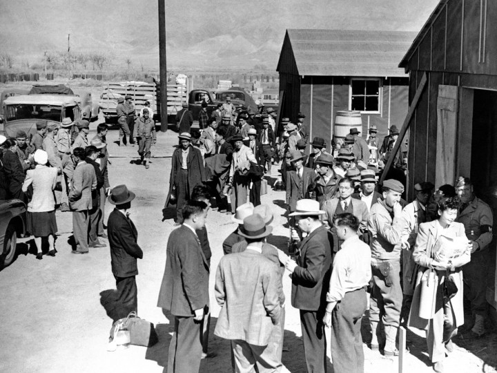 This March 23, 1942 file photo shows the first arrivals at the Japanese evacuee community established in Owens Valley in Manzanar, Calif., part of a vanguard of workers from Los Angeles. Roughly 120,000 Japanese immigrants and Japanese-Americans were sent to camps that dotted the West because the government claimed they might plot against the U.S. (AP Photo/File)