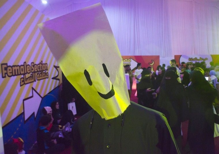 A visitor wears a mask near the female section during the Saudi Comic Con (SCC) which is the first event of its kind to be held in Jiddah, Saudi Arabia, Friday, Feb. 17, 2017. (AP Photo)