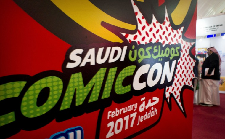 A visitor enters Saudi Comic Con (SCC) which is the first event of its kind to be held in Jiddah, Saudi Arabia, Thursday, Feb. 16, 2017. (AP Photo)
