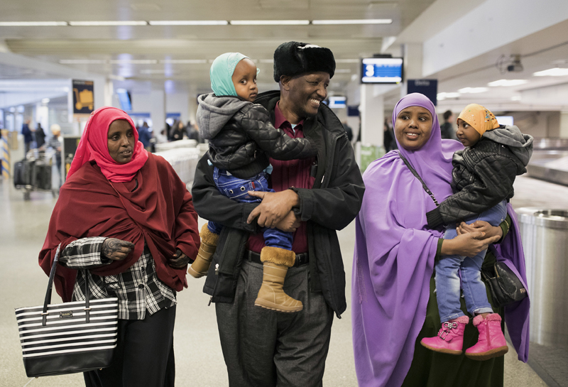 Reunions and protests as travel ban winds through courts