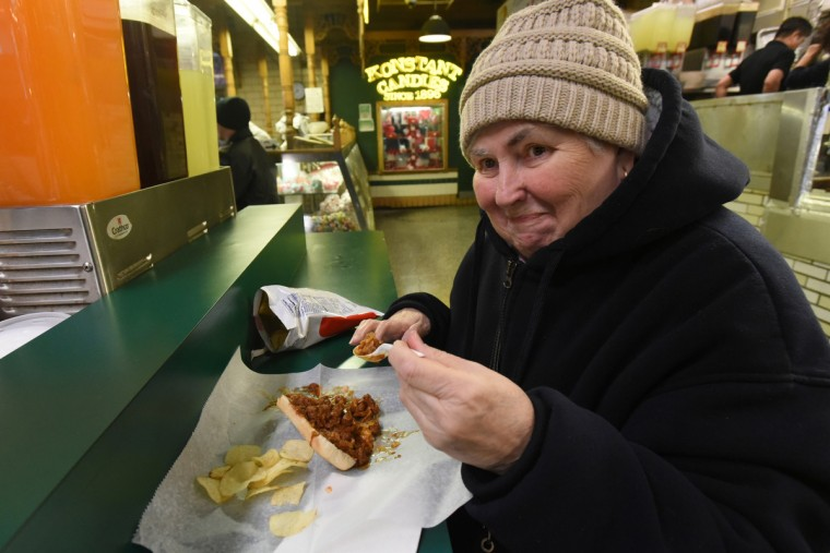 Jeanette Kerner, 73, has been coming to the Konstant's stand at Lexington Market for 54 years, and the staff knows what she likes: chili, mustard and onion on a roll, without a hot dog.  Konstant's has been at the market since 1896.  (Amy Davis/Baltimore Sun)