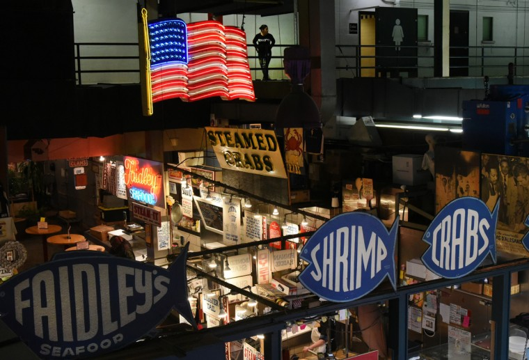 Looking down at Faidley's Seafood, one of the best known attractions at Lexington Market. John W. Faidley Sr, started the business in 1886, and it is now run by the third generation of the family. (Amy Davis/Baltimore Sun)