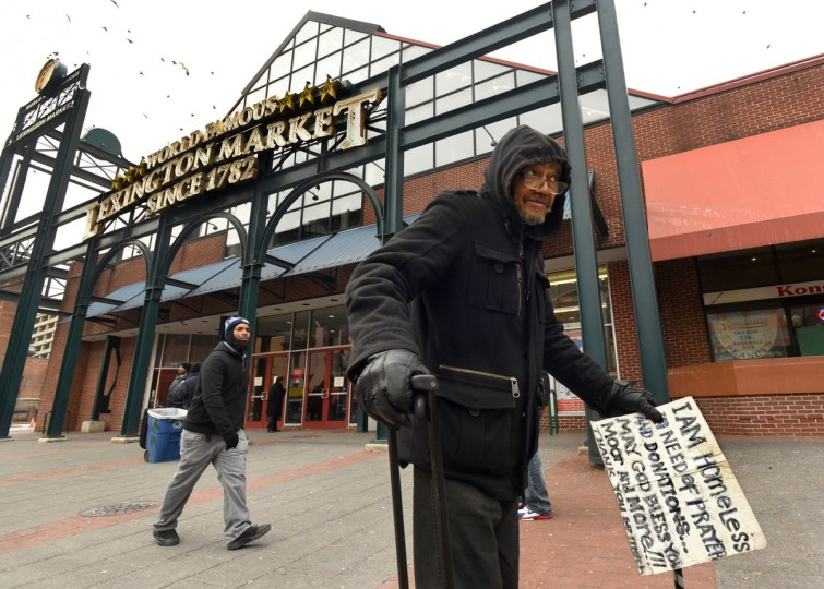 "David Rosser, 70, who is homeless, is a regular at Lexington market, where he says people know him as ""Papa 2.""  The market offers fresh food for surrounding neighborhoods that are considered ""food deserts,"" but urban issues of crime and poverty present challenges for the market, and for its image. (Amy Davis/Baltimore Sun)"
