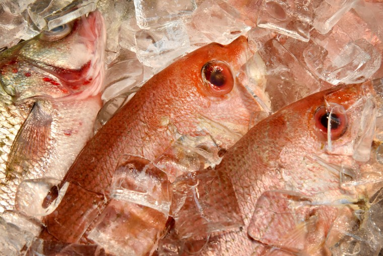 Detail of rockfish, left, and red snapper, center and right, on display at Harbor Fish, a stall at Lexington Market East. (Amy Davis/Baltimore Sun)
