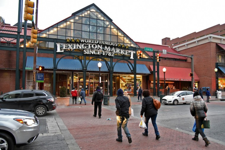 Pedestrians head toward the East Market entrance of Lexington Market, on N. Eutaw Street. Before this addition with the glass entrance was constructed, Lexington Street continued between N. Eutaw and N. Paca Streets. (Amy Davis/Baltimore Sun)