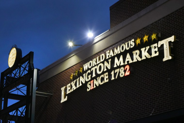 "Signage promotes Lexington Market's slogan: ""World-Famous Since 1782.""  After more than two centuries in operation, the market has plans to remake itself again. (Amy Davis/Baltimore Sun)"