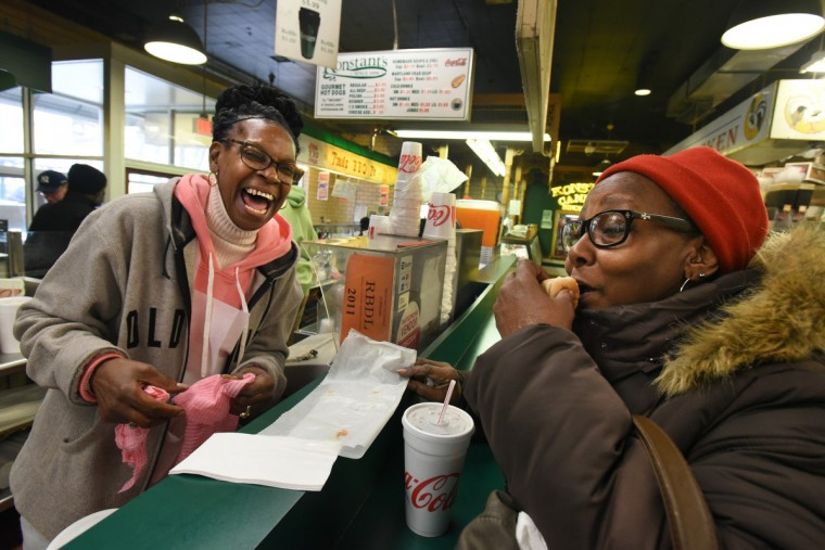 "Lois Boone, who has worked at Konstant's, located near the Eutaw Street entrance of Lexington Market, for 30 years, serves Vivian Jenkins, 65, of West Baltimore. Boone said, ""I like the people. I'm a people person.""  (Amy Davis/Baltimore Sun)"