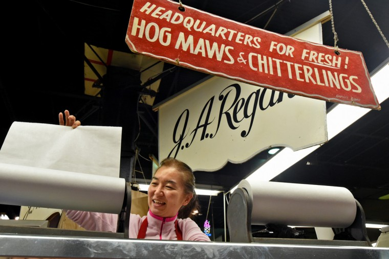 Grace Cho, who purchased the J.A. Regan business two years ago with her husband Philip Cho, says she respects the history of Lexington Market, including the old signs.  Cho, who is from South Korea, wasn't familiar with items like hog maws and chitterlings before coming to the market. (Amy Davis/Baltimore Sun)