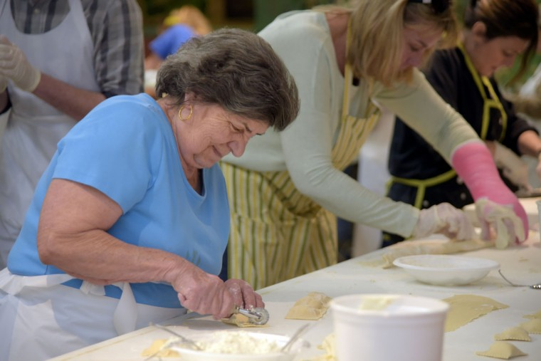 Teresa Corapi, 80, cuts ravioli squares. (Algerina Perna/Baltimore Sun)