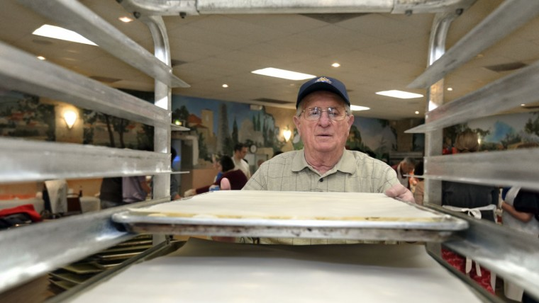 John Kidwell who was raised in Little Italy and now lives in Westminster loads ravioli trays into the tray rack. (Algerina Perna/Baltimore Sun)