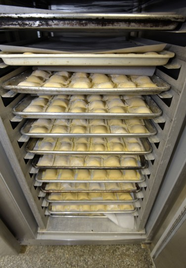 Ravioli is stacked in trays in the freezer. A few days after freezing, the ravioli will be transferred to small plastic bags until the day of the dinner when they will be cooked. (Algerina Perna/Baltimore Sun)