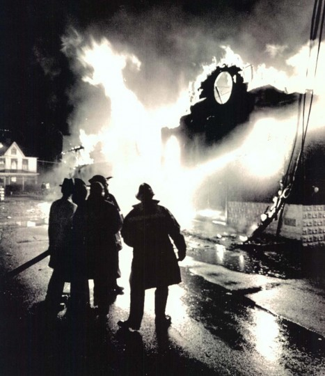 Residents assist firemen at a black church burns in Cambridge after the 1967 riot. (AP photo)
