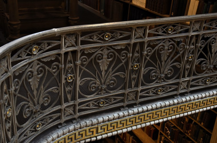 Cast iron railings are a distinctive feature  of the atrium at the George Peabody Library.  (Barbara Haddock Taylor/Baltimore Sun)
