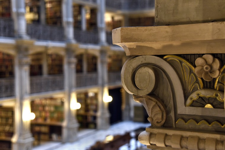Gold-scalloped columns are interspersed between cast-iron railings in the Peabody Library.  (Barbara Haddock Taylor/Baltimore Sun)
