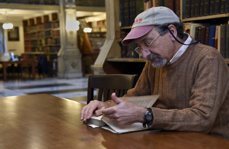 Larry Fask of Reisterstown reads a 1937 history of Worcester, MA (his hometown) at the Peabody Library.  (Barbara Haddock Taylor/Baltimore Sun)