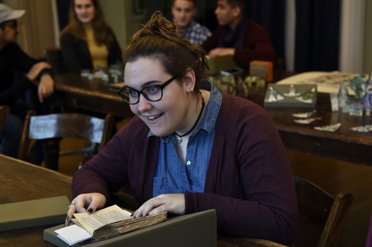 "Elizabeth Winkelhoff, 20, is a Johns Hopkins University student who is taking a class on the history of the George Peabody Library. She and other students were looking at 19th century Scottish ""chat books"" that are part of the library's collection.  (Barbara Haddock Taylor/Baltimore Sun)"