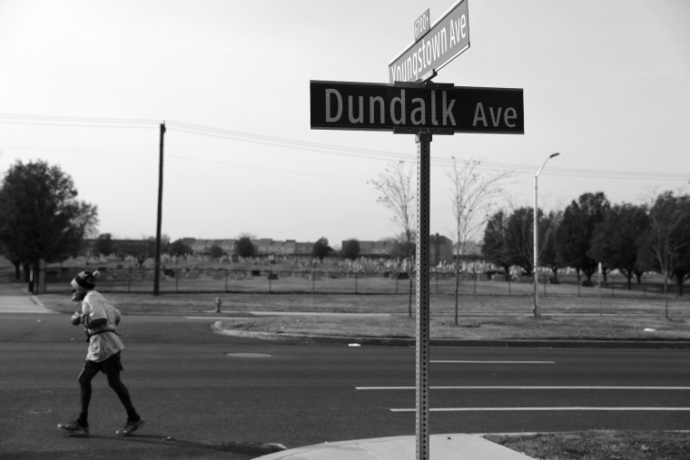 "Keith Boissiere runs on Dundalk Avenue on November 28, 2016 in Dundalk, Maryland. Despite living in West Baltimore, the 'Running Man' often runs into Baltimore County where there is far less foot traffic, cars and crime. ""When I am running through those bad neighborhoods, I have to keep an eye out,"" Boissiere said. ""But when I am in a good neighborhood I don't have to worry about [crime]."" But his health took a turn for the worse in 2008 - the streak ended - as his life almost did, too. Through all of his troubles, which includes being on a kidney donor recipient list, Boissiere copes the only way he knows how - he continues to run - as the hospital encouraged him to do in order to aid his failing health. He doesn't brag about his accomplishments or mention his celebrity-like status despite being constantly acknowledged - and these days barriers such as rain, snow and hospital appointments often dictate his running schedule. His drive and passion for his own health is often described as bringing positivity and strength to residents in the city, and the people of Baltimore still witness the 'Running Man' from West to East, and North to South, as he competes with only himself to stay upright by staying fit in a city plagued by: drugs, guns, crime, and violence. (Patrick Smith/Getty Images)"