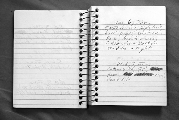 A detailed view of a Keith Boissiere's running journal dated Tuesday, June 6, 2000 is seen on December 5, 2016. In the form of yearly journals, the 'Running Man' writes short descriptions of his runs in small spiral notebooks which include: the weather, location, and other types of exercise. Whether hot or cold, in the tranquil streets of the county or a problematic block of West Baltimore, it's jotted down in ink. However, there is one traumatic situation he cannot erase from his memory. In November 2014, Boissiere was attacked during a run that left him with a cut and bruise on his face. Keith Boissiere has been running nearly every day for the past three decades - averaging more than 20 miles per day - for his health. Many residents only know the enigmatic figure by his nickname of the 'Running Man.' (Patrick Smith/Getty Images)