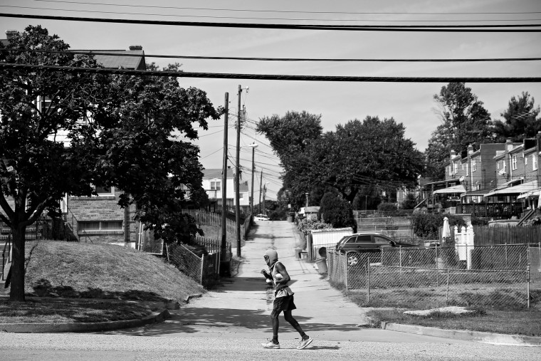 Keith Boissiere runs on Benson Avenue, a rural suburb of Baltimore City, on September 15, 2016 in Halethorpe, Maryland. The juxtaposition from rural to city is often noticed by the 'Running Man' during some of his favorite routes. This route through Halethorpe and Violetville is much quieter despite this same route bookending in community that faces many crime related challenges. (Patrick Smith/Getty Images)