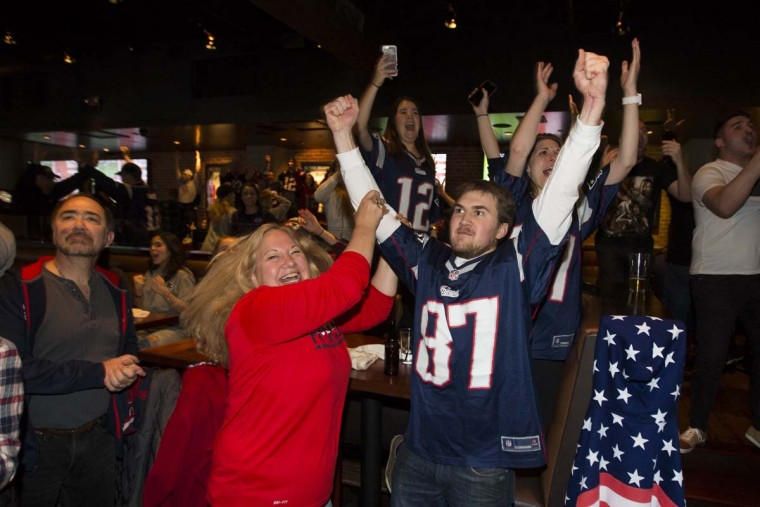 New England Patriots fans celebrate at Tony C's after the New England Patriots beat the Atlanta Falcons in overtime 34-28 during Super Bowl LI, February 5, 2017 in Boston, Massachusetts. (Photo by Scott Eisen/Getty Images)