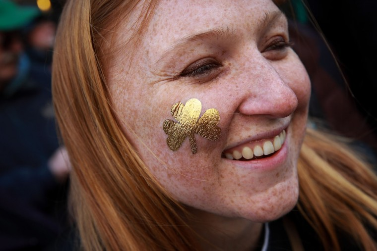 A spectator wears a painted on shamrock as she watches the annual St. Patrick's Day parade on 5th Avenue, March 17, 2017 in New York City. The New York City St. Patrick's Day parade, dating back to 1762, is the world's largest St. Patrick's Day celebration. (Photo by Drew Angerer/Getty Images)